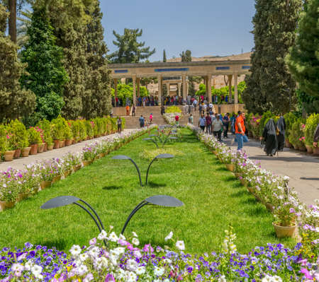 hafez: SHIRAZ, IRAN - MAY 2, 2015: Visitors take a tour of the mausoleum of Saadi, known also as the tomb of Sady or Sadiyeh.