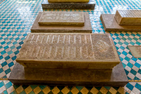 hafez: SHIRAZ, IRAN - MAY 2, 2015: The marble graves of famous Iranians in the mausoleum near the tomb of Hafez. Editorial