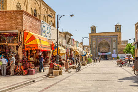 iran: SHIRAZ, IRAN - MAY 2, 2015: People in casual mood on the Vakil Bazaar square in the old part of the city near Citadel. Editorial