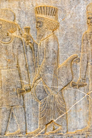 nobleman: Persian nobleman on their way to the royal feast relief detail on the stairway facade of the Apadana at the old city Persepolis.