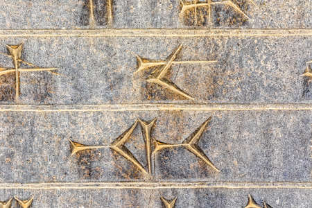 fars: Part of ancient cuneiform closeup detail on the stairway facade of the Apadana at the Persepolis, Iran. Stock Photo