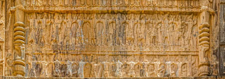 fars: Royal tombs facade view of the carriers of the royal throne to his eternal resting place, ruins of old city Persepolis. Stock Photo