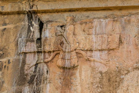 fars: Faravahar Royal tombs detail of the Zoroastrianism, symbol on the ruins of old city Persepolis. Stock Photo