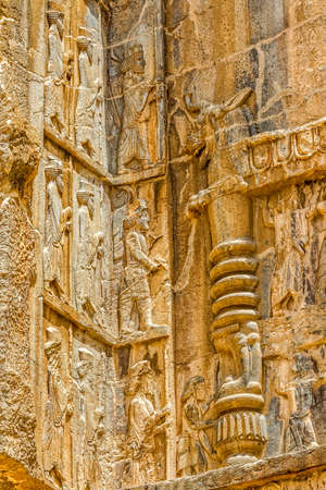 fars: Royal tomb detail on the corner, ruins of old city Persepolis. Stock Photo