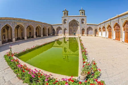 shiraz: SHIRAZ, IRAN - MAY 2, 2015: Visitors take a tour of the beautiful inner courtyard of the Nasir al-Mulk Mosque is a traditional mosque located in Goad-e-Araban place.