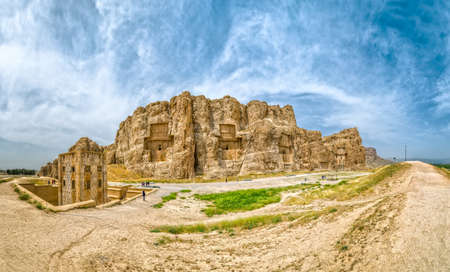 fars: NAQSH-E RUSTAM, IRAN - MAY 3, 2015: Persian crosses historical monuments of ancient necropolis near ruins of old city Persepolis.