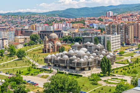 PRISTINA, KOSOVO - JULY 01, 2015: Aerial view of capital city with some old buildings like National Public Library and Christ the Saviour Cathedral. Publikacyjne