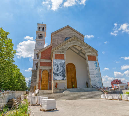 Mother Teresa: PRISTINA, KOSOVO - JULY 01, 2015: View to the main entrance of The Roman Catholic Cathedral of Blessed Mother Teresa in the city center.