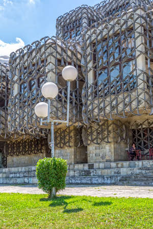 architectural lighting design: PRISTINA, KOSOVO - JULY 01, 2015: Unusual exterior of the famous building of the National library of Kosovo designed by architect Andrija Mutnjakovic in the city center.