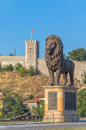 european culture: SKOPJE, MACEDONIA - JULY 17, 2015: One of four statues of the Macedonian Lion placed below the Kale fortress on each site of the bridge over the river Vardar.