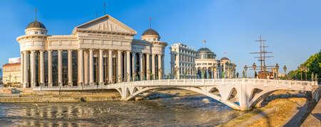 macedonian: SKOPJE, MACEDONIA - JULY 17, 2015: Panoramic view of the Macedonian archaeological museum building and the art Eye Bridge on river Vardar. Editorial
