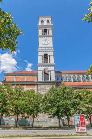 Mother Teresa: PRISTINA, KOSOVO - JULY 01, 2015: Clock tower and belfry of the Roman Catholic Cathedral of Blessed Mother Teresa view from the street.