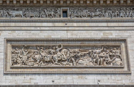 honors: PARIS, FRANCE - JULY 9, 2015: The Arc de Triomphe detail with Battle of Jemappes, is the famous monument that honors those who fought and died for France.
