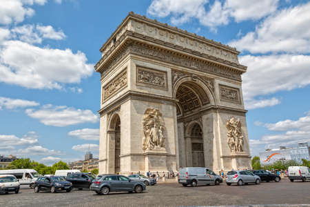 honors: PARIS, FRANCE - JULY 9, 2015: The Arc de Triomphe in the city center is the famous monument that honors those who fought and died for France.
