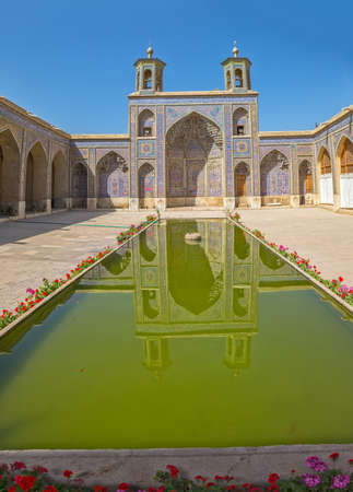shiraz: Beautiful courtyard with pool reflection of the Nasir al-Mulk Mosque is a traditional mosque located in Goad-e-Araban place in Shiraz.