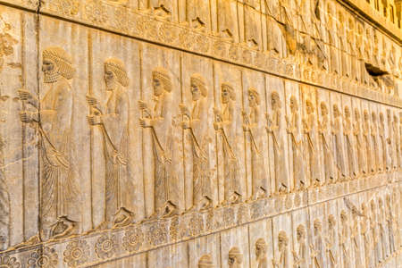 guardians: Guardians also known as the Immortals holding a spear, relief detail on the stairway facade of the Apadana at the old city Persepolis. Stock Photo