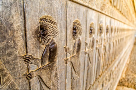 fars: Guardians also known as the Immortals holding a spear, relief detail on the stairway facade of the Apadana at the old city Persepolis. Stock Photo