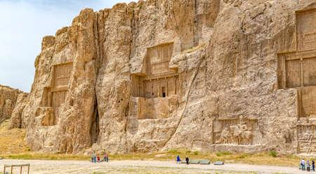 necropolis: NAQSH-E RUSTAM, IRAN - MAY 3, 2015: The historical monuments of ancient necropolis near ruins of old city Persepolis.