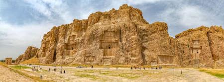 fars: NAQSH-E RUSTAM, IRAN - MAY 3, 2015: The historical monuments of ancient necropolis near ruins of old city Persepolis.
