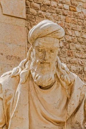 north gate: SHIRAZ, IRAN - MAY 3, 2015: Khwaju Kermani Statue in the Quran Gate, a historic gate in the north of the city.