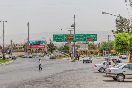 north gate: SHIRAZ, IRAN - MAY 3, 2015: People and cars at the intersection on north partg of town, next to the Quran Gate. Editorial