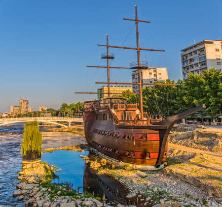 shores: SKOPJE, MACEDONIA - JULY 17, 2015: A large wooden sailing ship stranded on the shores of the river Vardar, turned into a restaurant. Editorial