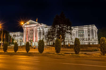 new rules: SKOPJE, MACEDONIA - JULY 17, 2015: White government building and road on summer night.