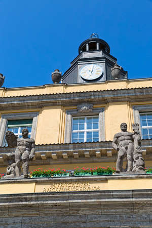 oswald: MUNICH, GERMANY - JUNE 4, 2015: Clock ditail of the old building on Koniginstrasse 107, castle-like complex built in 1912-13 by Oswald E. Bieber and Wilhelm Hollweck, near English garden. Editorial