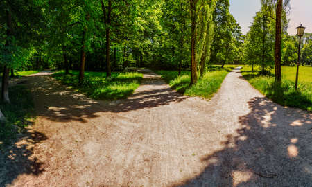 english famous: Panoramic view of the three tracks in the English garden famous city park in Munich. Stock Photo