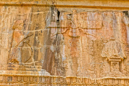 fars: Faravahar Royal tombs facade detail of the Zoroastrianism, symbol on the ruins of old city Persepolis. Stock Photo