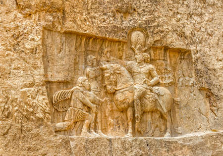 fars: Ancient relief of the necropolis Naqsh-e Rustam that shows the triumph of Shapur I over the Roman Emperor Valerian and Philip the Arab, near ruins of Persepolis.