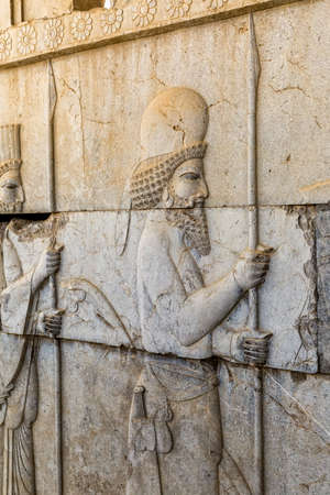 residents: Stone bas-relief of residents of historical empire carved on the stairway facade of the Apadana at the old city Persepolis, capital of the Achaemenid Empire.
