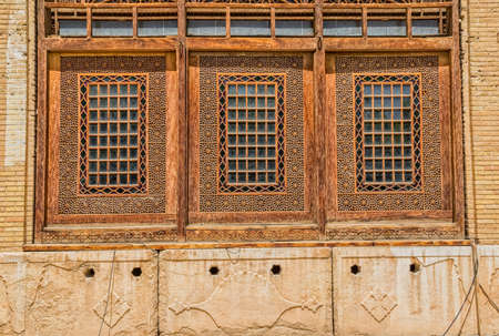 shiraz: SHIRAZ, IRAN - MAY 2, 2015: Wooden windows inside of the old citadel Karmin Khan in the centre of the city.