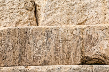 cyrus: Tomb of Cyrus the Great detail of the stairs, is the most important monument in Pasargadae old ruins near Shiraz in Iran. Stock Photo