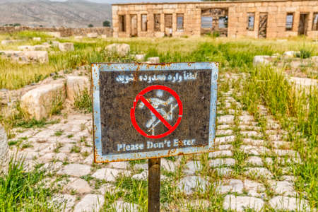 cyrus: Sign infront of the Mozaffarid caravansarai, part of the old archaeological site near the tomb of Cyrus the Great in Pasargad Iran. Stock Photo