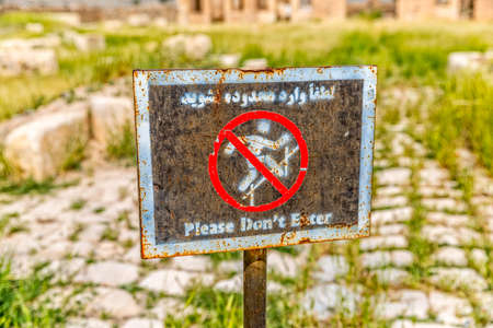 interdiction: Sign infront of the Mozaffarid caravansarai, part of the old archaeological site near the tomb of Cyrus the Great in Pasargad Iran. Stock Photo