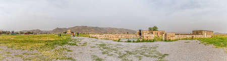 cyrus: PASARGAD, IRAN - MAY 4, 2015: Panoramic view of the tourists checking out the tomb of Cyrus the Great and the Mozaffarid caravansarai. Editorial