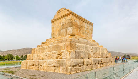 fars: PASARGAD, IRAN - MAY 4, 2015: The group of tourists with the tour guide checking out the tomb of Cyrus the Great. Editorial