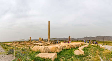 tour guide: PASARGAD, IRAN - MAY 4, 2015: The group of tourists with the tour guide checking out the archaeological site of the old city.