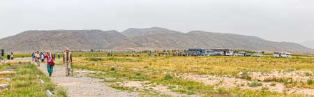 tour guide: PASARGAD, IRAN - MAY 4, 2015: Panoramic view of the groups of tourists with the tour guide checking out the archaeological site of the old city. Editorial