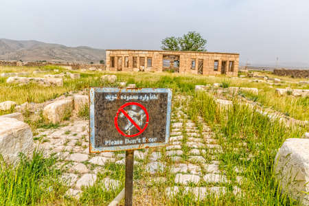 cyrus: PASARGAD, IRAN - MAY 4, 2015: Sign infront of the Mozaffarid caravansarai, part of the old archaeological site near the tomb of Cyrus the Great. Editorial