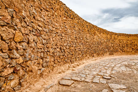 the silence of the world: Curved wall at the top of the tower of silence in Yazd, Iran. Stock Photo