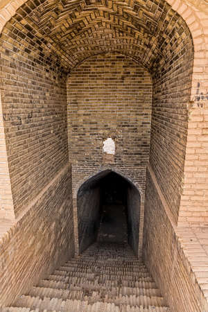 architectural tradition: Old cooling building entrance at the foot of the hill with Towers of Silence in Yazd, Iran.
