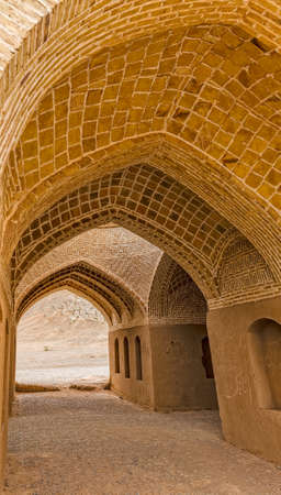 iran: Disused old building interior at the foot of the hill with Towers of Silence in Yazd, Iran.