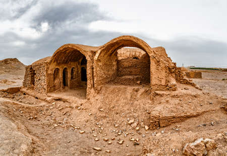 the silence of the world: Old building ruin at the foot of the Tower of Silence in Yazd, Iran.