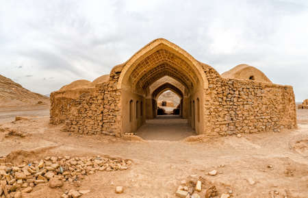 iran: Disused old building at the foot of the Tower of Silence in Yazd, Iran. Stock Photo