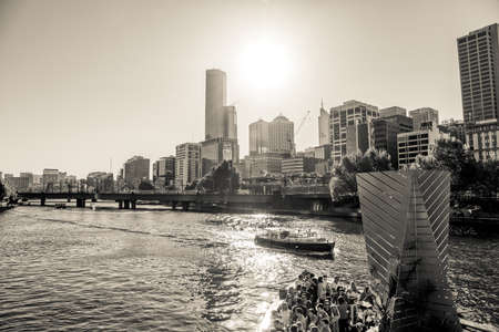 southbank: MELBOURNE, AUSTRALIA - MARCH 21, 2015: Black and white view of Southbank footbridge and its Ponyfish Island restaurant on Yarra river on the beautiful sunny day.