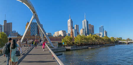 southgate: MELBOURNE, AUSTRALIA - MARCH 21, 2015: View of Southbank footbridge and city on Yarra river on the beautiful sunny day.