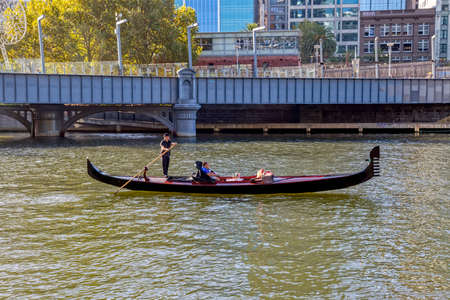 gondolier: MELBOURNE, AUSTRALIA - MARCH 21, 2015: A romantic ride in a gondola with the gondolier, on Yarra River at autumn season. Editorial