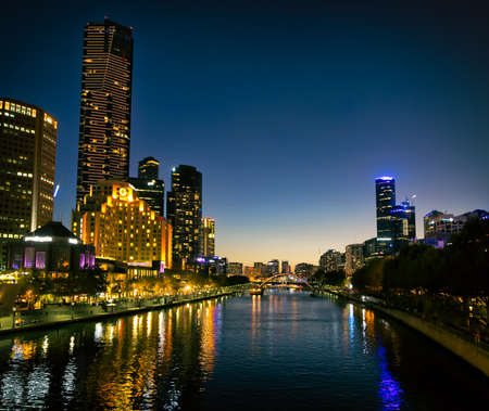 southgate: MELBOURNE, AUSTRALIA - MARCH 21, 2015: Southbank high skylines and buildings, one of the primary business centers and also one of the most densely populated areas at twilight.